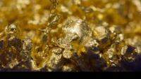 Златото се търгува за над 1800 долара за тройунция след разочароващи данни от САЩ